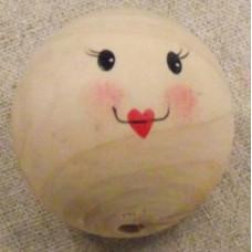Trä huvud med målat ansikte